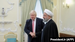 File photo - Iranian President Hassan Rohani (R) meets with Boris Johnson, then British Foreign Secretary in the capital Tehran, December 10, 2017