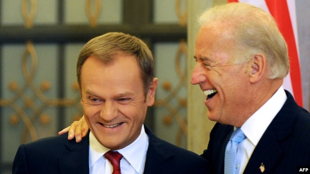 U.S. Vice President Joe Biden (right) shares a lighter moment with Polish Prime Minister Donald Tusk during their meeting in Warsaw on October 21.