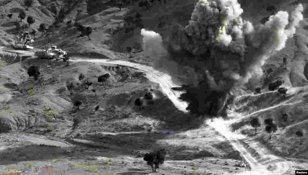 U.S. soldiers blow up a roadside bomb set up by Taliban fighters near the town of Walli Was in Paktika Province, Afghanistan. (Reuters/Goran Tomasevic)