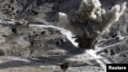 U.S. soldiers blow up a roadside bomb set up by Taliban fighters near the town of Walli Was in Paktika Province last month.