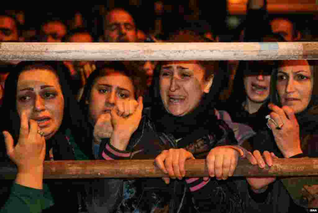 Balal's relatives cry as the time of the execution approaches.