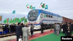 Locals from the Turkmen village of Ak Yayla join in the celebrations during the opening ceremony for a railway linking Kazakhstan, Turkmenistan, and Iran, which was inaugurated late last year.