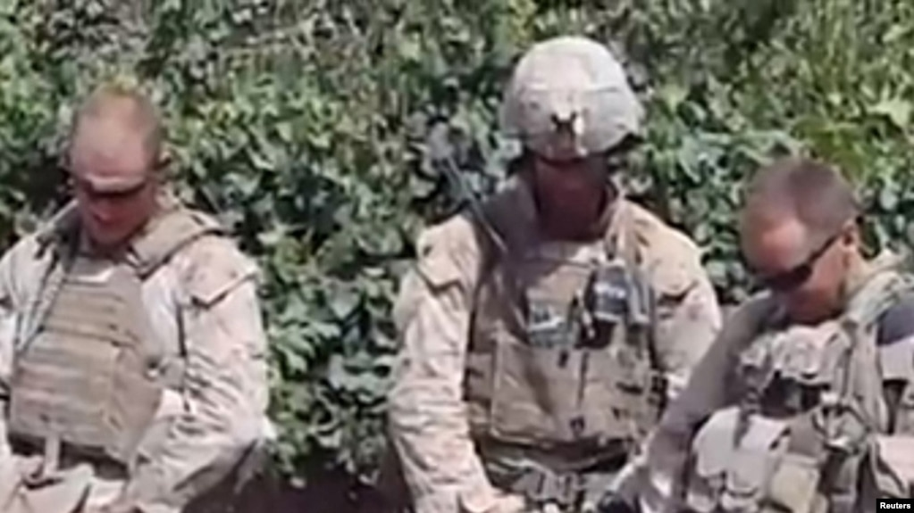 two marines to face trial for defiling corpses