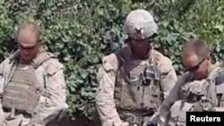 A screen grab from the video that appears to show Marines urinating on the bodies of dead Taliban