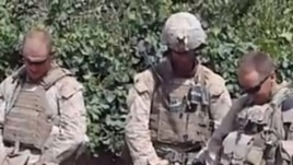 A screen grab from a YouTube video showing Marines urinating on the bodies of dead Taliban soldiers in Afghanistan.