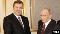 Ukrainian President Viktor Yanukovych (left) shakes hands with Russian Prime Minister Vladimir Putin during his working visit to Kyiv in October. Is Russia the model Yanukovych's government aspires to bring to Ukraine?