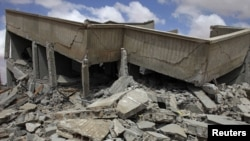 A house lies in rubble after a NATO airstrike near the village of Shal Ghouda in western Libya on August 11.