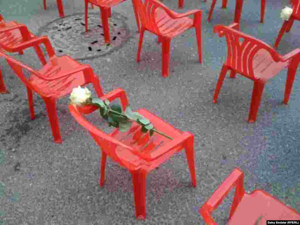 Smaller chairs represent the 643 children killed during the siege. (RFE/RL / Daisy Sindelar)