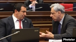 Armenia - Prosperous Armenia Party leader Gagik Tsarukian (L) and former Foreign Minister Vartan Oskanian speak during a parliament session in Yerevan, 4Feb2013.