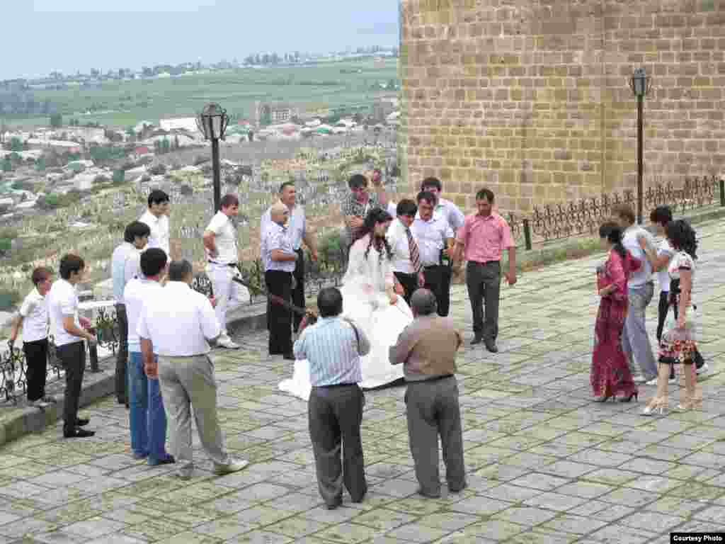 A wedding in the southern Daghestani city of Derbent - It's local tradition for the bride and groom to visit the Sassanian fortress in Derbent.