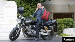 Greek Finance Minister Yanis Varoufakis arrives for a meeting at the office of the prime minister in Athens in July 2015.