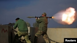 Iraqi forces fire a rocket launcher during a battle with Islamic State militants in Mosul on January 18 (file photo).