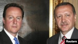 British Prime Minister David Cameron (left) with Turkish Prime Minister Tayyip Erdogan in Ankara on July 26