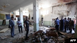 Iraqis inspect the damage at a Shi'ite place of worship after a suicide bomber attacked worshipers during prayers in eastern Baghdad. Shi'ite worshipers are often targeted by IS militants.