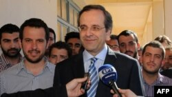"Leader of the New Democracy conservative party, Antonis Samaras, pledged to form a ""national salvation"" government to keep the country using the euro."
