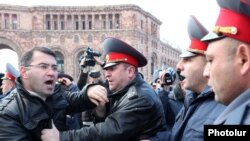 Armenia -- Opposition MP Armen Martirosian scuffles with police officers, 3Mar2011.