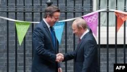 Takimi Kamerun - Putin në Dauning Strit 10 në Londër