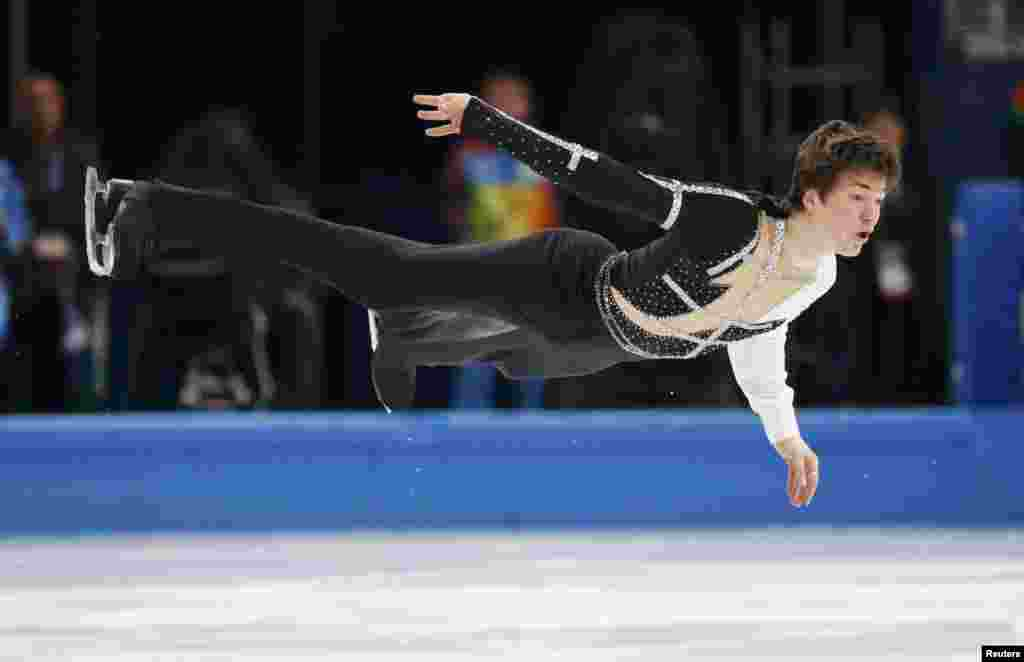 Ukraine's Yakov Hodorozha competes during the figure skating men's short program.