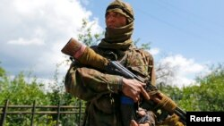 A June 22 photo from the Donetsk region city of Siversk shows a Kalashnikov-carrying separatist identified as Bakhtiyor, a native of Uzbekistan.