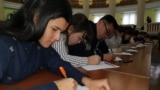 Kazakhstan - Students write dictation in Latyn alphabet of Kazakh language. Almaty, 14November2018