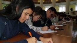 Kazakhstan - Students write dictation in Latyn alphabet of Kazakh language. Almaty, 14November2018