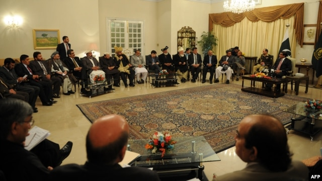 Pakistani Prime Minister Raja Pervez Ashraf (top right) talks with Afghan parliament members during a meeting in Islamabad on December 11.