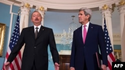 U.S. Secretary of State John Kerry (right) speaks with Azerbaijani President Ilham Aliyev in Washington on March 30.