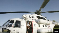 A UN helicopter arrives to evacuate UN workers in Herat, in western Afghanistan.