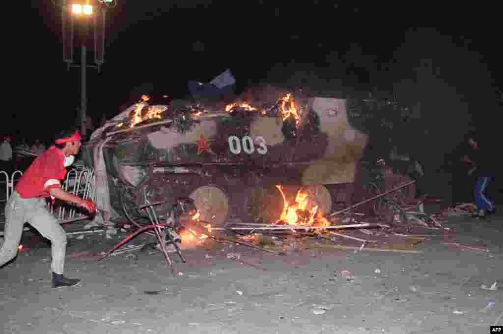 On the night of June 3, troops began to move against the protesters with tanks and armored vehicles. In this photo from June 4, students set an armored personnel carrier on fire.
