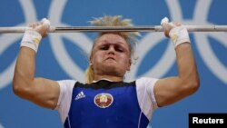 Belarus's Maryna Shkermankova competes in the women's 69Kg Group A weightlifting competition at the ExCel venue at the London 2012 Olympic Games.