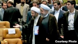 File photo-Head of Judiciary Sadegh Larijani and President Hassan Rouhani.