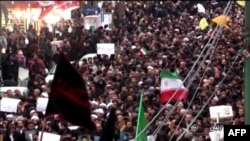 Islamic Republic of Iran Broadcasting shows Iranians chanting slogans as they march in support of the government in the northwestern city of Zanjan on January 1.