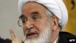 Mehdi Karrubi speaks during a press conference in Tehran in 2008.