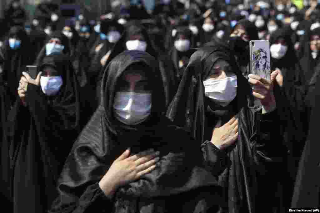 Mourning women wear protective face masks to help prevent the spread of the coronavirus during the annual ceremony commemorating Ashura at the Saleh shrine in northern Tehran on August 30.