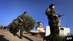 Iranian Kurdish female fighters take part in a training session in Dibis, some 50 kms northwest of Kirkuk, Iraq, September 15, 2014