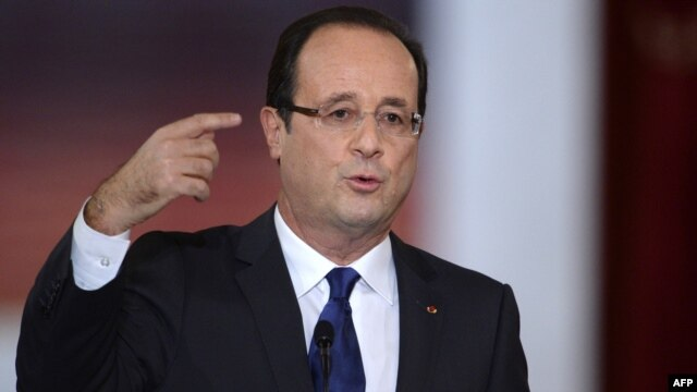 French President Francois Hollande announces French backing of the new Syrian opposition coalition at a major press conference at the Elysee Place in Paris on November 13.