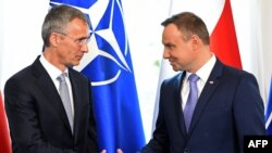 NATO Secretary-General Jens Stoltenberg (left) and Polish President Andrzej Dudameet hold a press conference in the Belweder Palace in Warsaw on July 7.