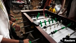 For Islamic State militants, foosball is permitted, provided that it complies with the IS interpretation of Islamic law prohibiting statues and portraits. (file photo)