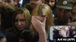 Czech model Tereza Hluskova weeps after the court decision to sentence her to eight years and eight months in prison for attempted heroin smuggling in Lahore on March 20.