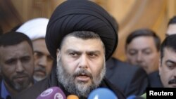 Iraqi Shi'ite cleric Muqtada al-Sadr speaks to the media during a visit to the Our Lady of Salvation Church in Baghdad on January 4.