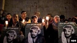 На Западном Берегу палестинцы отмечают годовщину смерти Арафата, 11 ноября 2013 года
