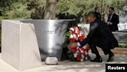 U.S. President Barack Obama lays a wreath at the grave of former Israeli Prime Minister Yitzhak Rabin at Mt. Herzl in Jerusalem on March 22.