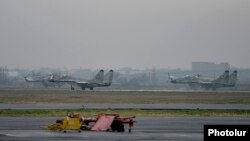 Armenia - Russian MiG-29 fighter jets and Armenian Mi-8 helicopters at the Erebuni airbase in Yerevan, 12Mar2016.