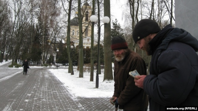 Vyachaslau (left) and Syarhey begging for money outside the Peter and Paul Cathedral in Homel.