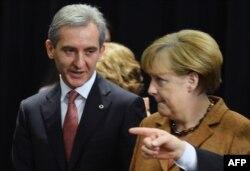 Permierul Iurie Leancă şi cancelara Angela Merkel la summitul de la Vilnius, 29 noiembrie 2013