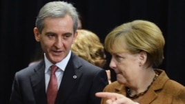 Moldovan Prime MInister Iurie Leanca (left) talks with German Chancellor Angela Merkel during the European Union's Third Eastern Partnership Summit in Vilnius on November 29.