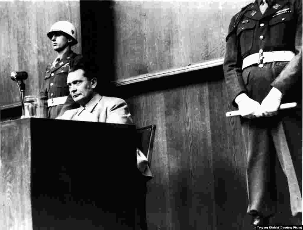 The most senior Nazi officer to have faced trial after the war, Hermann Goering is flanked by U.S. military policemen in the dock at Nuremburg