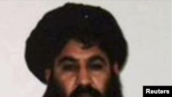 Mullah Akthar Mansur is seen in this undated handout photograph by the Taliban