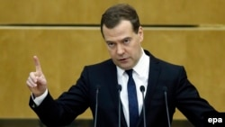 Russian Prime Minister Dmitry Medvedev delivers a speech during a session of the State Duma in Moscow on April 21.