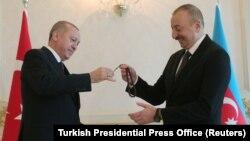 Azerbaijani President Ilham Aliyev (right) receives prayer beads from Turkish counterpart Recep Tayyip Erdogan in Baku during a visit in February.